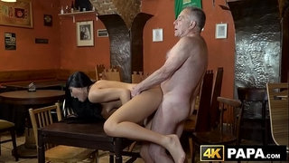 Naughty-vixen-seduces-and-rides-old-mans-dick-in-a-bar
