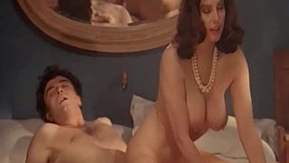 Busty-brunette-wife-riding-her-husband-in-bed