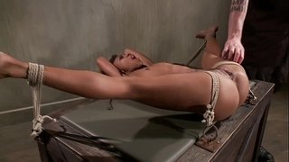 Tied-up-ebony-sub-obeys-her-master-during-their-bdsm-session