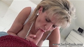 British-Lady-Sonia-finds-friends-son-on-her-bed,-and-sucks-his-cock