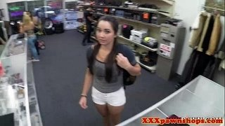 Real-pawnshop-amateur-showing-her-tits-off