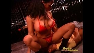 Mistress-Dressed-In-Red-Leather-Sits-On-Slave's-Face