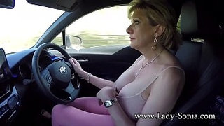 Mature-blonde-Lady-Sonia-plays-with-her-tits-while-driving