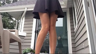Upskirt-milf-pees-standing-on-porch
