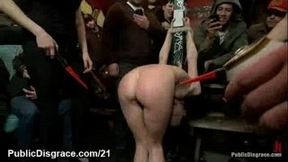 Tied-up-babe-cattle-proded-and-gangbang-fucked-in-public
