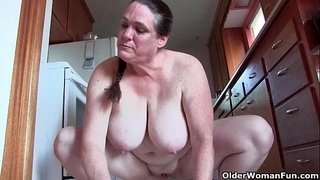 Granny-with-big-tits-cleaning-the-kitchen-naked