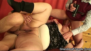 Busty-old-women-swallows-two-cocks