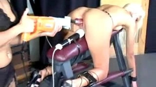 Blonde-Girl-Tied-To-Platform-In-Doggy-Getting-Fucked-With-Fuck-Saw-Clit-Stimulated-With-Vibrator-By