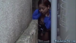 Asians-spied-on-pissing