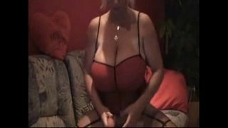 Blonde-with-monster-huge-breasts-playing-with-dildo