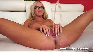 Pretty-blonde-in-glasses-uses-a-jelly-dildo-on-her-wet-pussy-to-orgasm