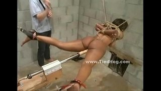 Nasty-mistress-with-ponytail-slapping-naked-sex-slave-tied-like-a-hog-in-ropes