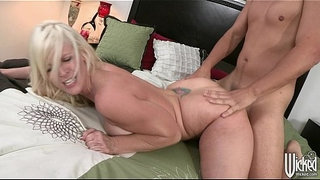 Big-tit-blonde-cougar-picks-up-a-young-stud-to-suck-&-fuck